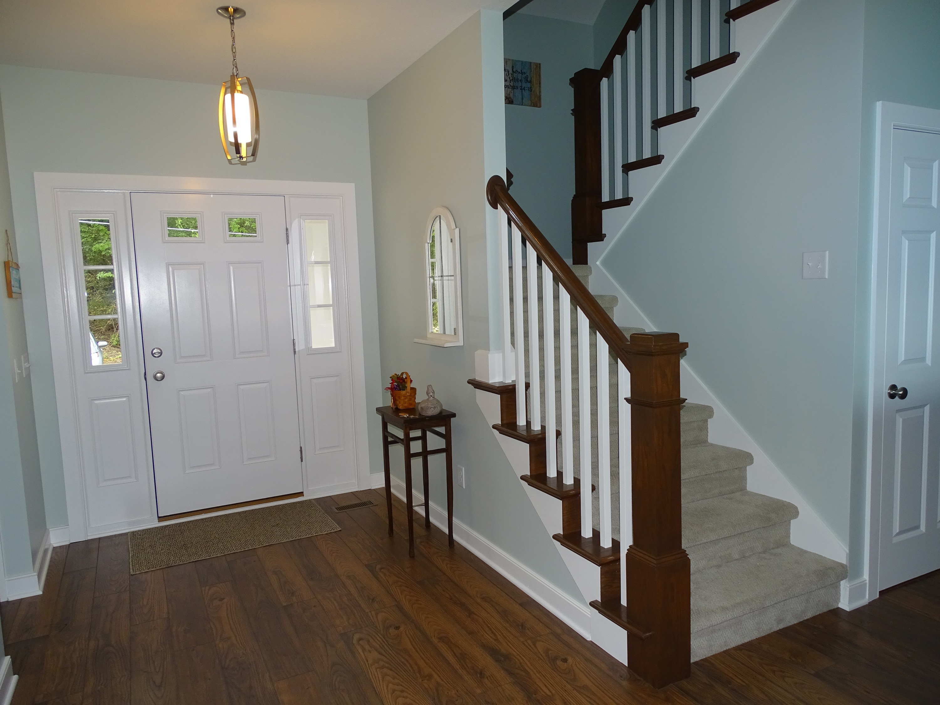 Staircase and foyer in lake home